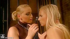 Barbie White and Kathia Nobili in femdom action
