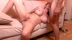 Voluptuous cougar June Summers fucks a stiff cock every way she can