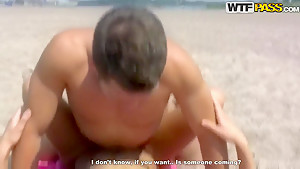 A perfect couple makes love on the beach